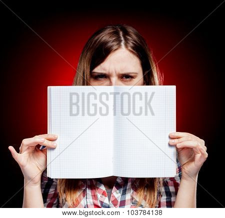 Disappointed And Angry Young Girl Holding Exercise Book