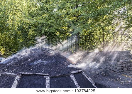 Burning Charcoal Pile In The Forest
