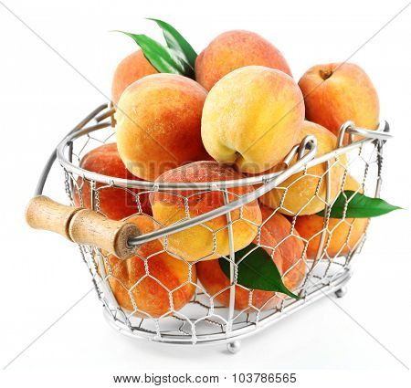 Ripe peaches in basket isolated on white