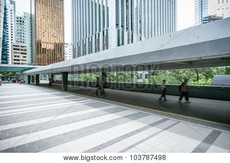 flyover among modern skyscrapers with people walking beneath