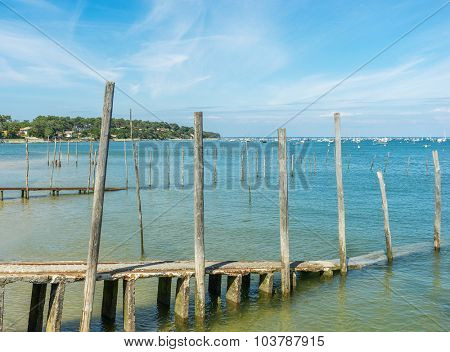 old and shabby wooden piers by the sea shore