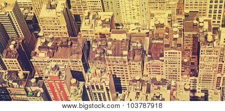 Vintage Filtered Panoramic View Of Manhattan Roofs.