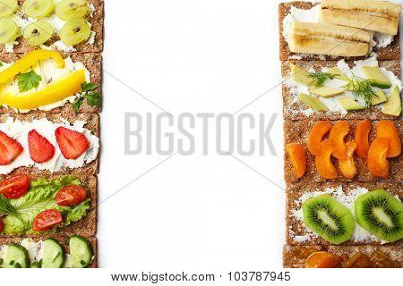 Tasty vegetarian sandwiches on white background