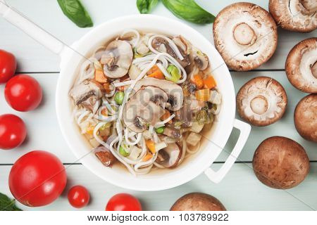 Clear portabello mushroom soup with noodle and vegetable