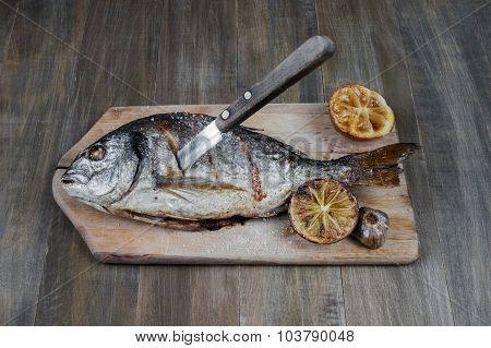 Prepared Fish On On The Old Wooden Table