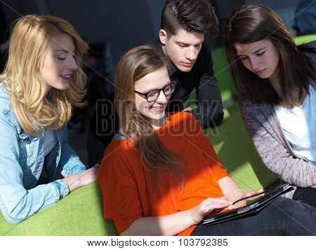 students group working on school  project  together on tablet computer at modern university, teamwork business concept