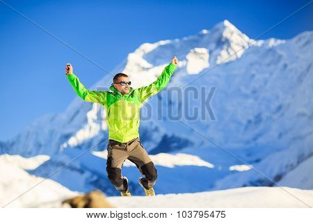 Man hiker or climber happy ecstatic achievement in winter mountains inspiration and motivation accom