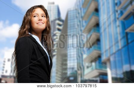 Confident business woman in a city