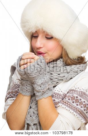Young girl with fur hat isolated
