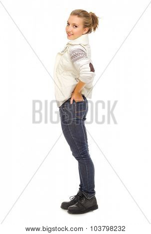 Young smiling girl in jeans isolated