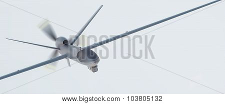 Drone UAV in flight, front view, over blue sky, 3D illustration