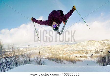 Skier mid backflip