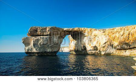 Azure Window, natural arch, famous landmark and popular tourist spot, on Gozo island, Malta,