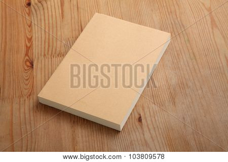 blank cover book on the wooden table