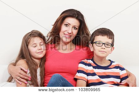 Happy Family. Mother And Kids On Sofa At Home.