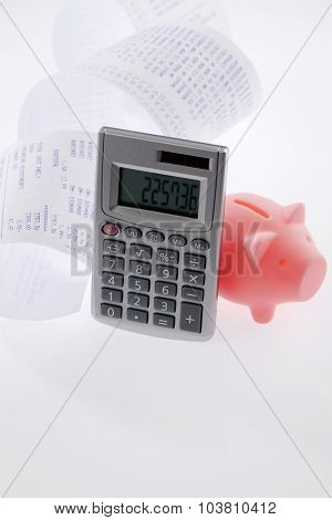 piggy bank and calculator on the white background