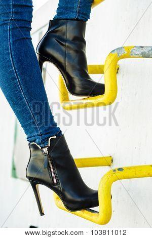 Woman Legs In Denim Pants Heels Shoes Outdoor