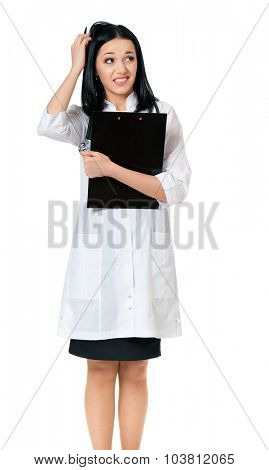 Young female doctor holding a clipboard, isolated on white background