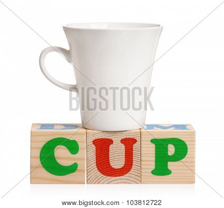 CUP word formed by wood alphabet blocks with cup, isolated on white background