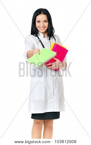 Beautiful young doctor with books, isolated on white background