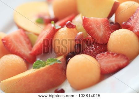 Summer fruit plate with pomegranate seeds