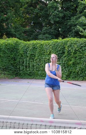 The image of girl plays tennis