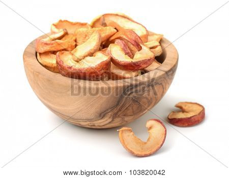 Dried apple slices in woodenl bowl isolated on white