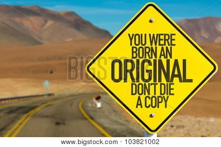 You Were Born An Original Don't Die a Copy sign on desert road