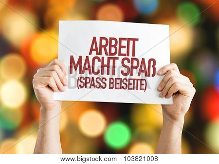 Work is Fun (Joking Aside) in German placard with bokeh background