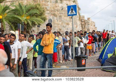 KOS, GREECE - SEP 28, 2015: Unidentified refugees. More than half are migrants from Syria, but there are refugees from other countries - Afghanistan, Pakistan, Iraq, Iran, Mali, Bangladesh, Eritrea.