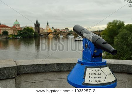 PRAGUE, CZECH REPUBLIC - AUGUST 18, 2015: telescope on the bridge over Vltava river. The Vltava is the longest river within the Czech Republic