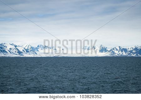 Glacier Above The Sea And Mountains Behind, Svalbard, Arctic
