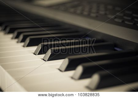 Abstract Background Of Piano Keyboard Synthesizer Closeup Key Frontal View