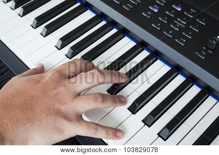 Hand On Piano Keyboard Synthesizer Closeup Key Frontal View