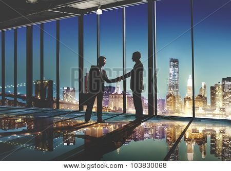 2 Multi-Ethnic Businessmen Shaking Hands Concept