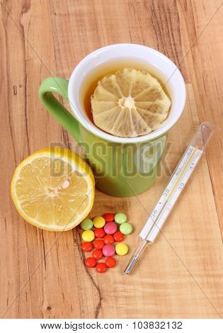 Pills, Thermometer And Hot Tea With Lemon For Colds, Treatment Of Flu And Runny