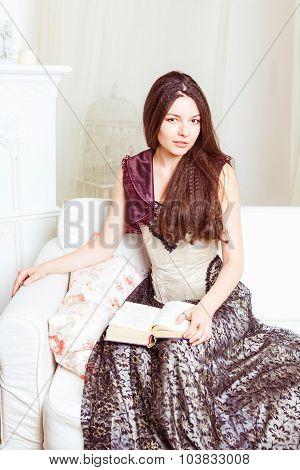 Beautiful woman reading old book