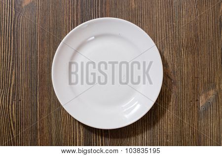 white plate on brown wooden table