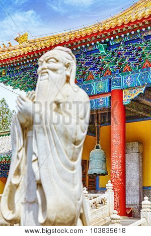 Statue Of Confucius, The Great Chinese Philosopher In Temple Of Confucius At Beijing.focus On The Ba