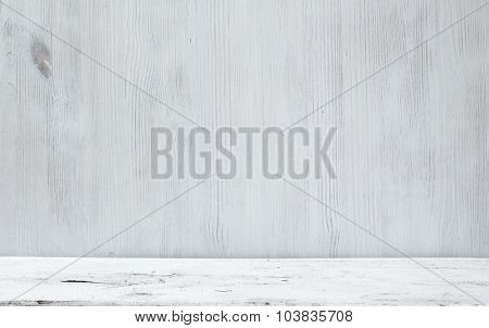 old white wooden table and gray wall