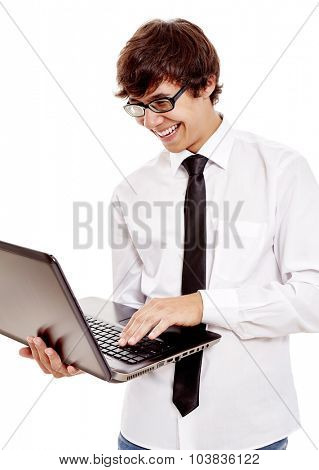 Young hispanic man wearing white shirt, black tie and glasses reading something funny from his laptop and laughing isolated on white background - humor and communication concept