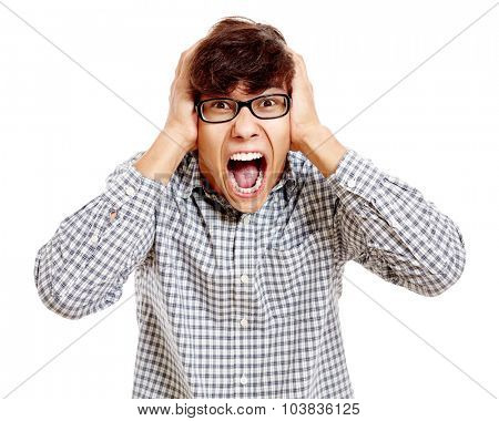 Young hispanic man wearing blue checkered shirt and black glasses standing with hands on his head and loudly screaming isolated on white background - success concept