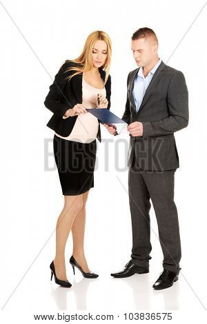 Working pregnant woman talking with her partner