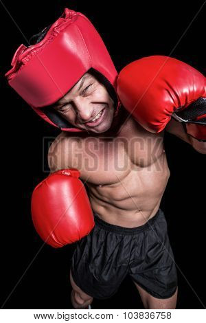 High angle view of boxer with headgear and gloves against black background