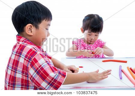 Asian Kids Playing With Play Clay On Table. Strengthen The Imagination