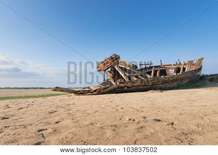 Old Boat At Low Tide In France, Normandy