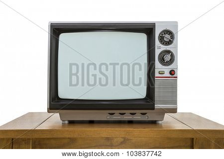 Vintage portable television and old wood table isolated on white