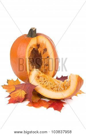 Decorative Pumpkin On Yellowed Maple Leaves