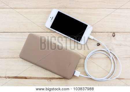 Smartphone With Golden Powerbank.
