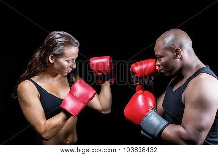 Athletes with fighting stance against black background